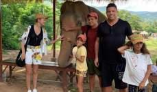 رونالدو يبتسم الى جانب فيل