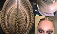 روندا روسي في تصفيفة شعر مجنونة