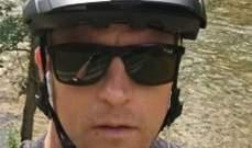 كيمي رايكونين على الدراجة في الغابة