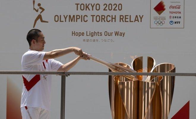 وصول الشعلة الاولمبية الى شينجوكو طوكيو