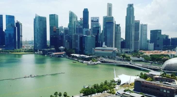 رومان غروجان يصل الى سنغافورة